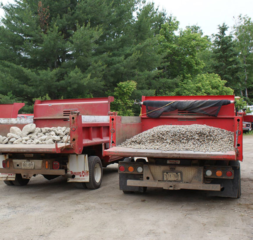 Small dump trucks with aggregate loads