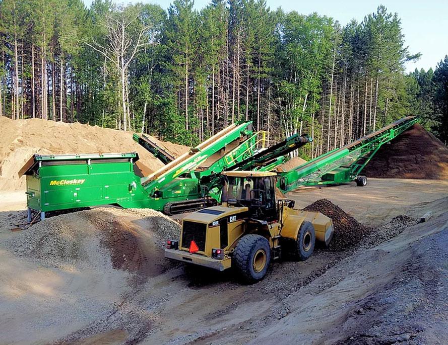 Front end loader & rock slinger in aggregate pit