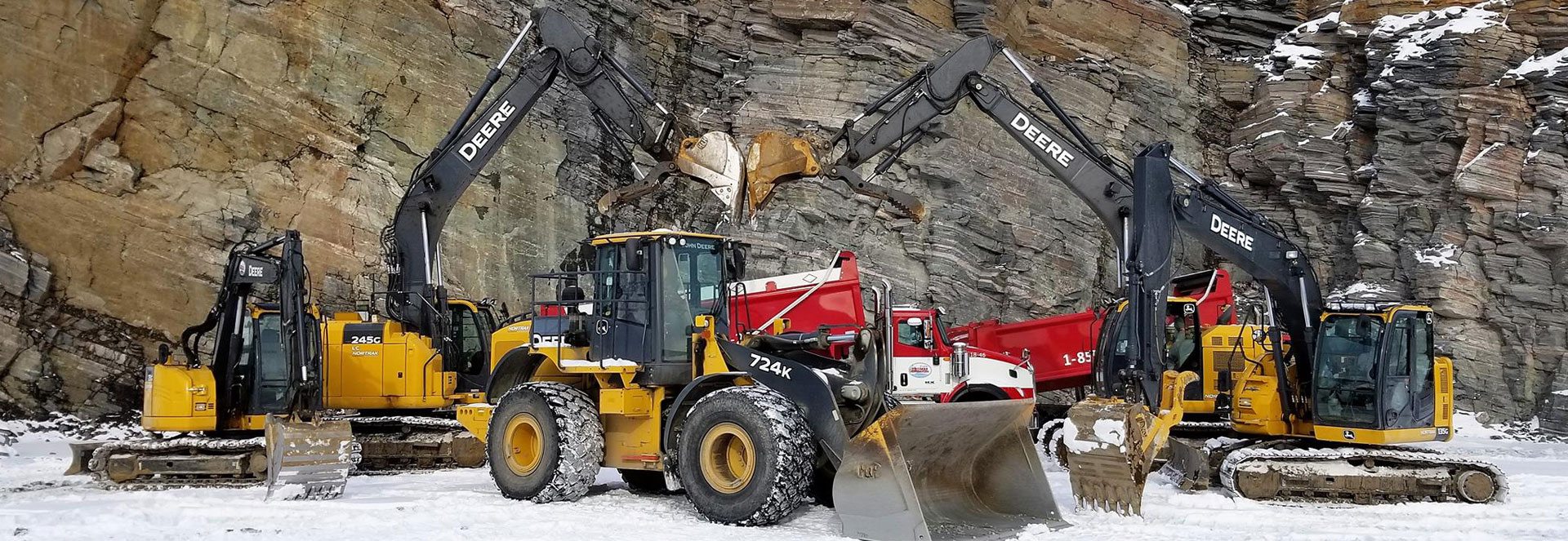 Photo of heavy equipment in quarry in winter