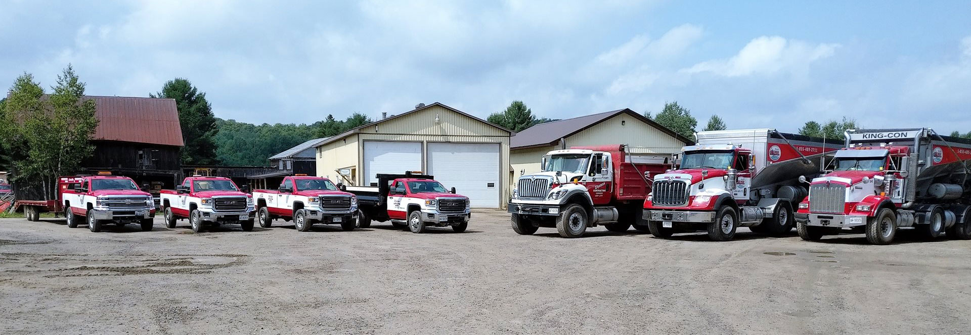 Our trucks & dumps lined up in a row