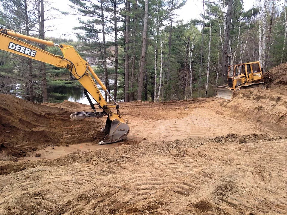 Image of excavator clearing land